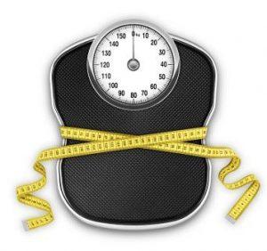Measurement tape around scale Diet vs. exercise