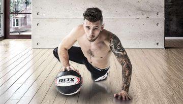 man holding RDX Medicine Ball