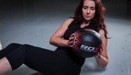 Woman Holding RDX Medicine Ball
